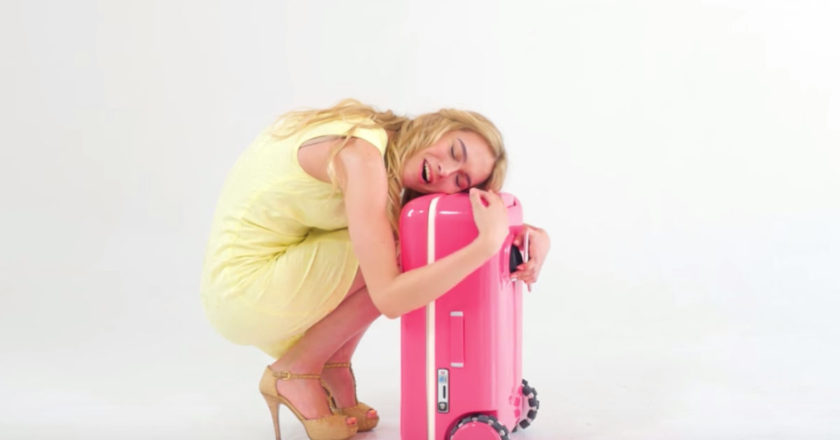 Woman hugging her suitcase, Travelmate Robotics, silicon valley, smart suitcase, robot suitcase, startups