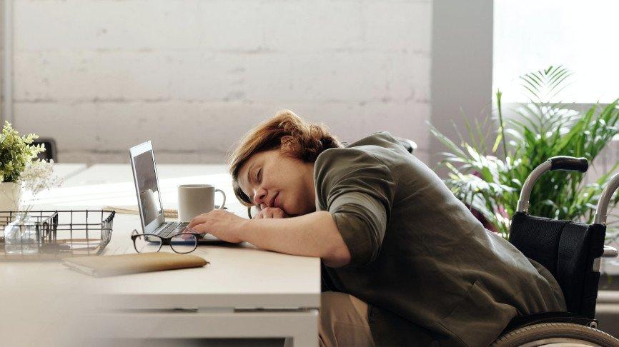 Woman Sleeping At Desk