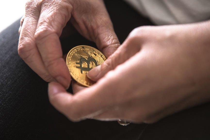 Man's hands holding Bitcoin