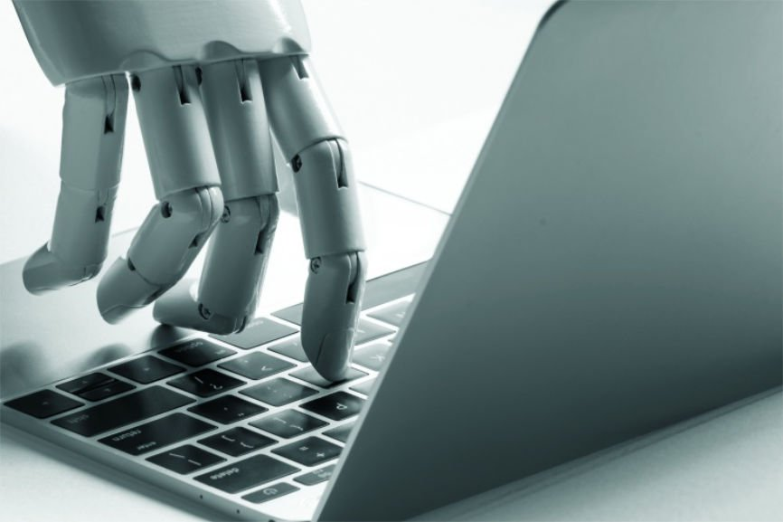 Robotic hand typing on laptop
