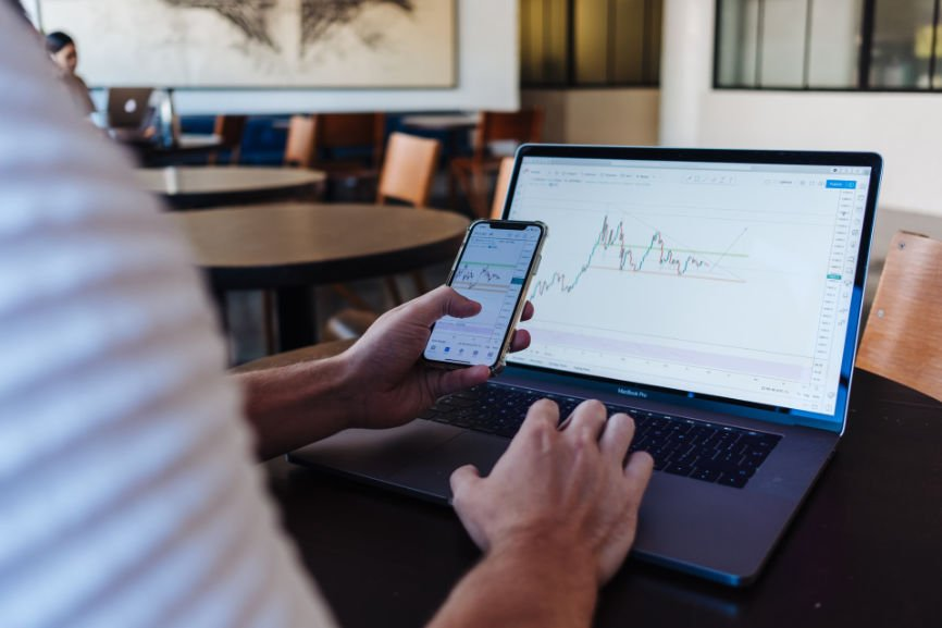Man using laptop and iPhone