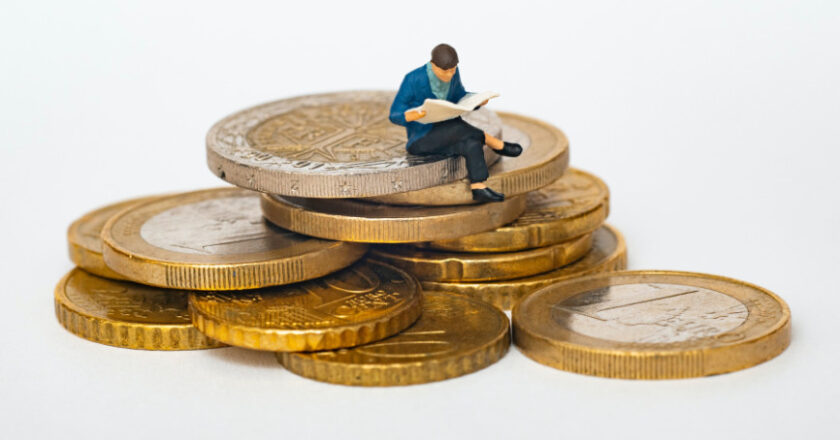 Illustration of man reading newspaper sitting on stacks of coins
