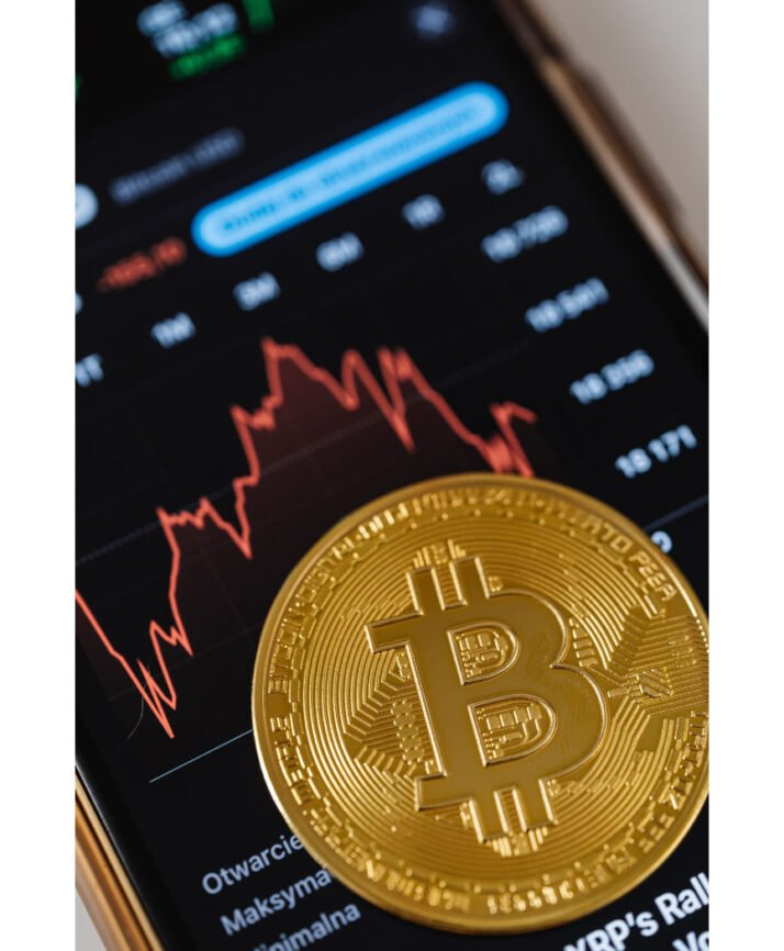 Bitcoin on Smartphone showing investment graph