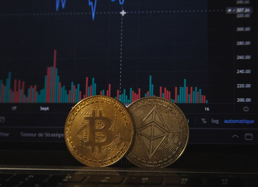 Bitcoins in front of a bar graph