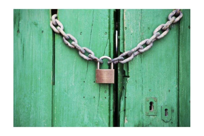 Chain and padlock around green doors