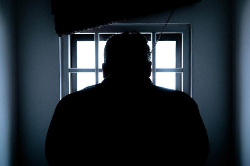 Silhouette of a man confined