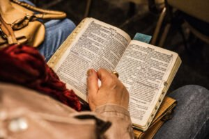 Open Bible on person's lap