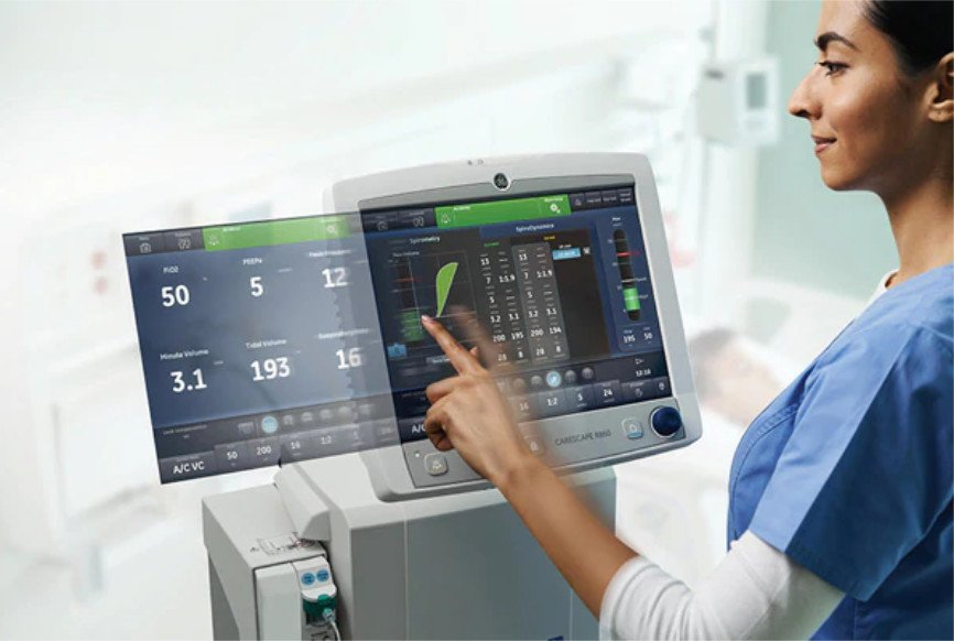 Nurse working a ventilator