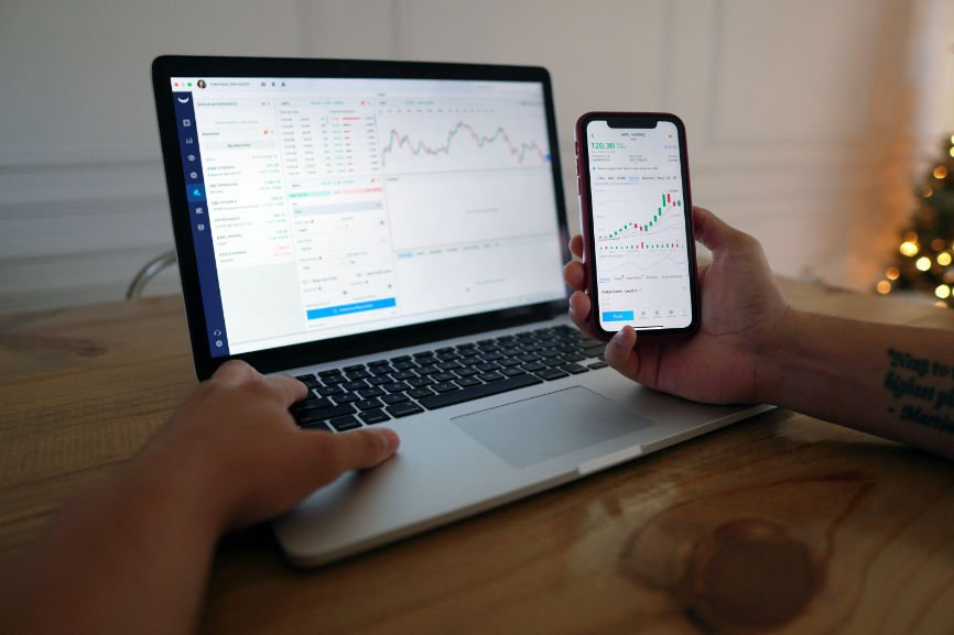 MacBook and iPhone displaying PDT day trades