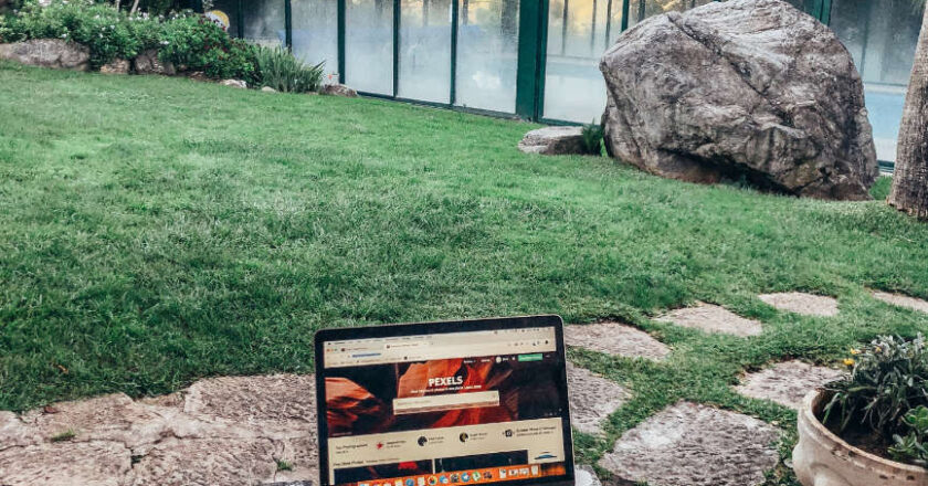 Laptop situated in a pleasant setting outdoors