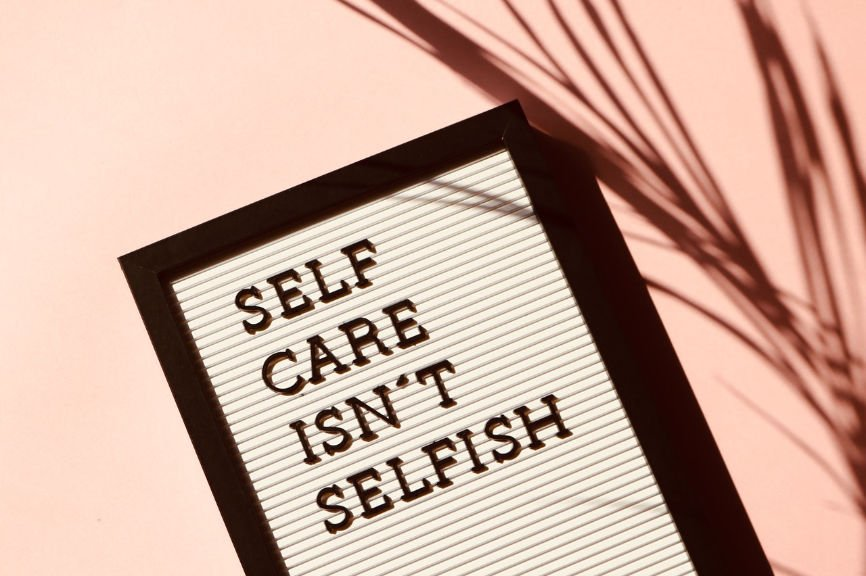 """Framed sign that reads """"Self Care Isn't Selfish"""""""