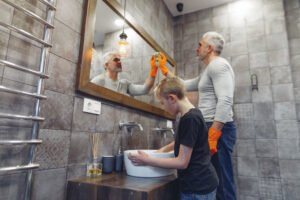 Man Cleaning Mirror, Boy cleaning sink