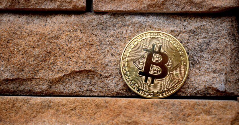 Bitcoin against a brick wall
