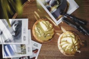 Appetizing mousse cakes near photographs