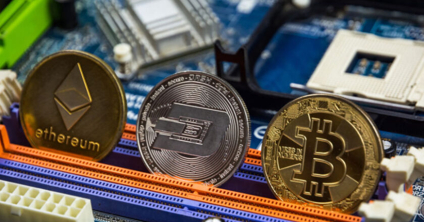 Crypto coins on circuit board