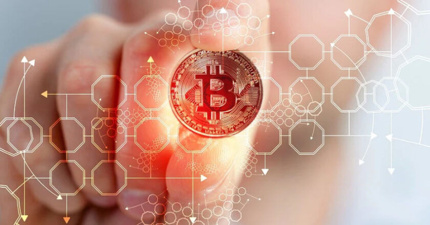 Abstract of man pointing to a bitcoin on a wall display