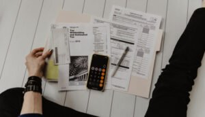 Person sitting infront of tax related paperwork