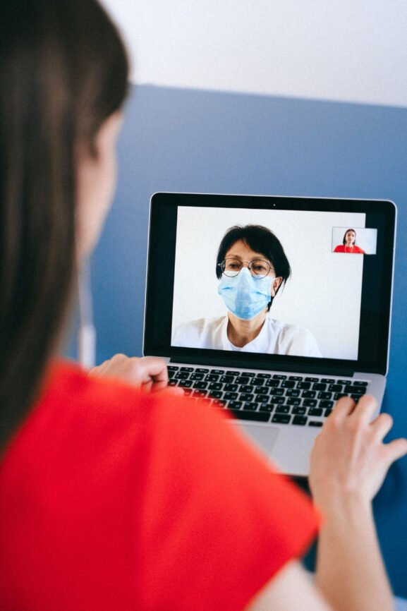 Woman and doctor visit via tele-med session