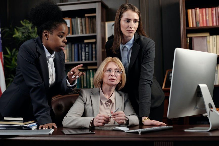 Attorneys looking at a computer monitor