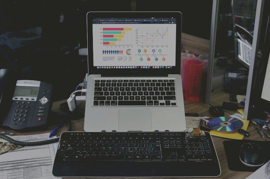 Laptop Displaying Graphs