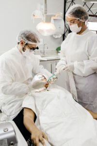 Dentist and assistant working on a patient
