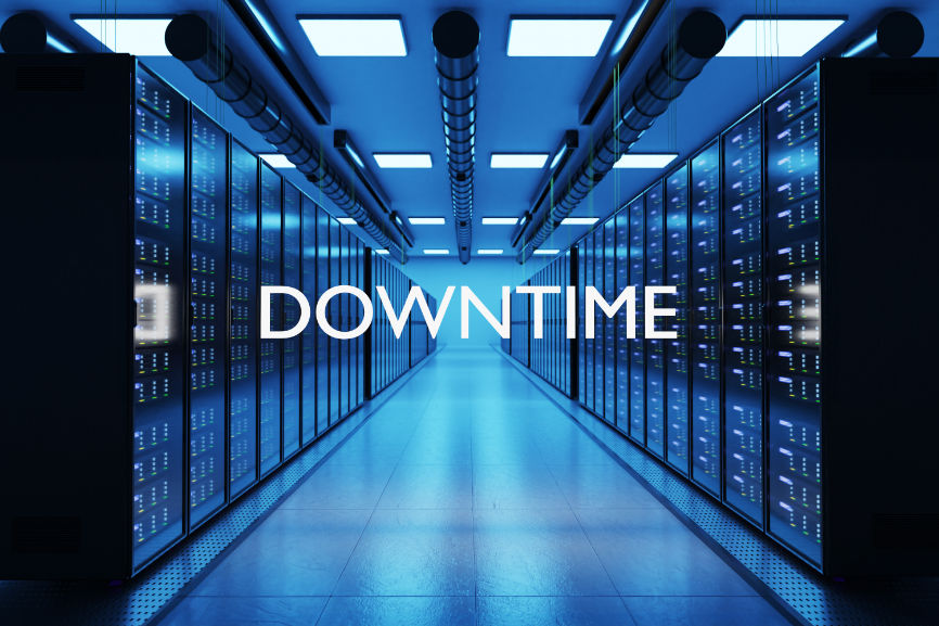"""Server room in blue light displaying the word """"DOWNTIME"""""""