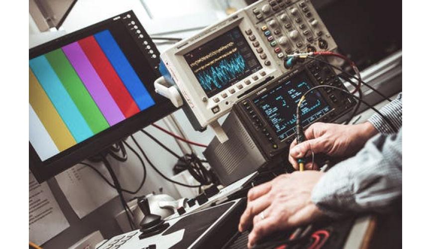 Mechanical Engineer working with digital equipment