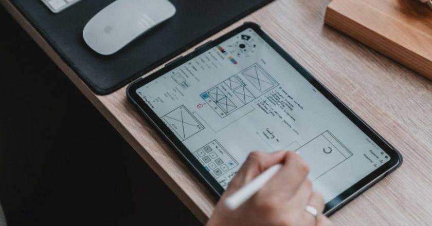 UI/UX Designer working on a tablet