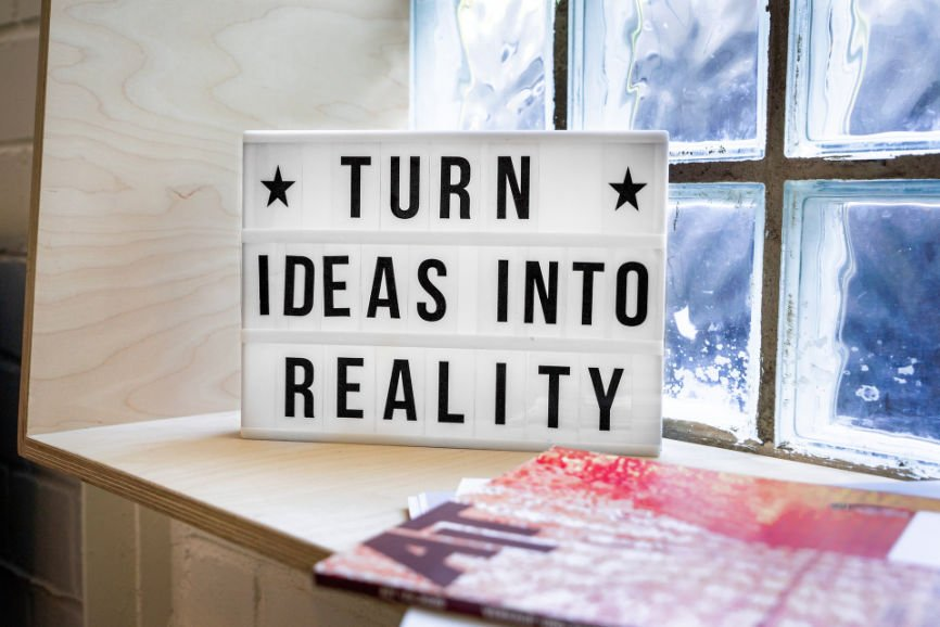 """A sign that reads """"Turn Ideas Into Reality"""""""