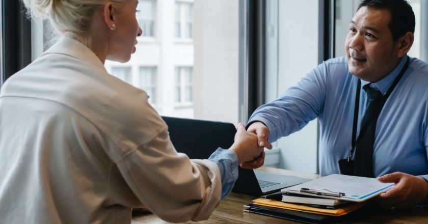 Recruiter shaking hands with female candidate