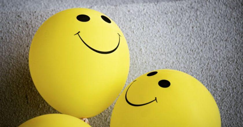 Smiley face yellow balloons representing good Mental Health