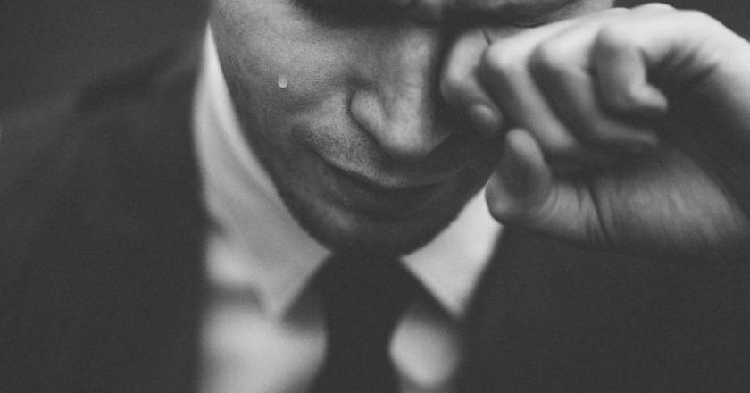 Man in suit under stress