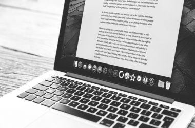 Proofreading text on a laptop