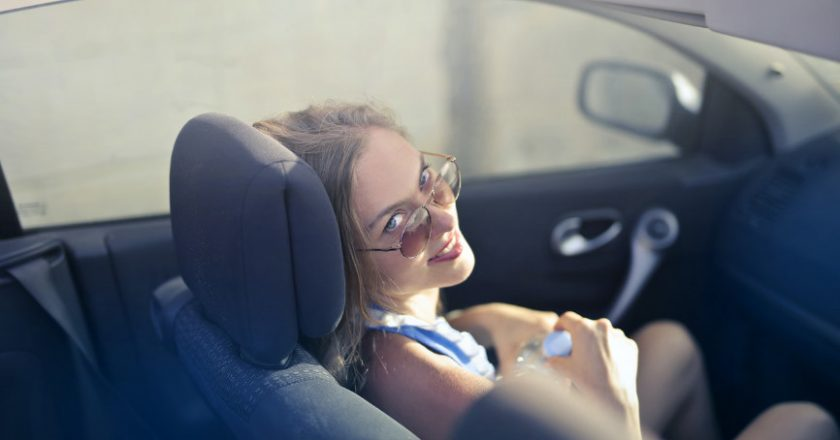 Girl in car with car accessories