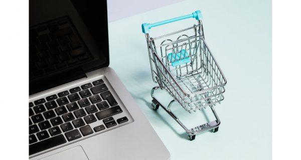 Shopping cart, laptop and cash