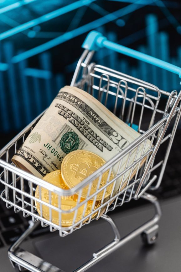 Fiat and digital currency in a shopping cart