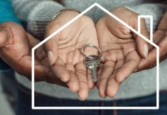 Hands holding keys to home