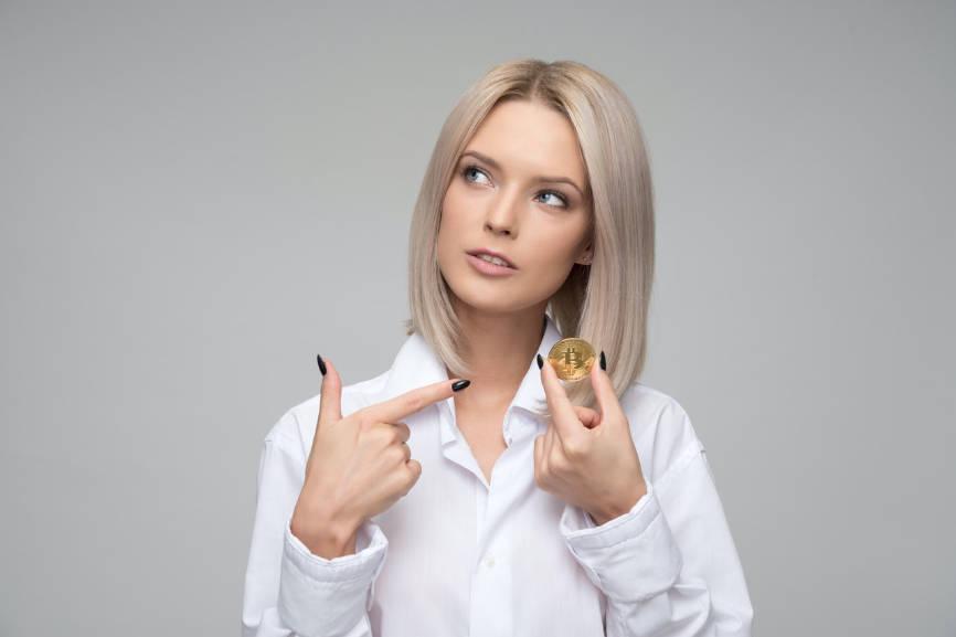 Woman pointing at a bitcoin