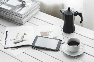 Tablet on a table with expresso coffee