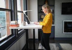 Woman working in front of Standing desk