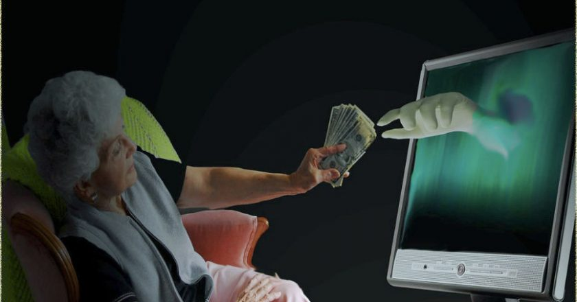 Woman handing money over to hand reaching out of a TV set, depicting fraud