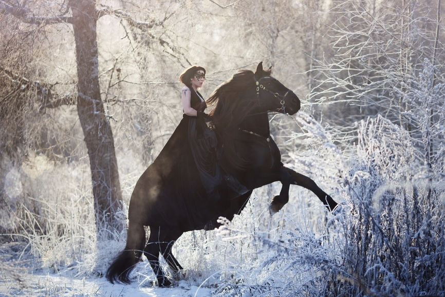Woman on horse back bonding with horse