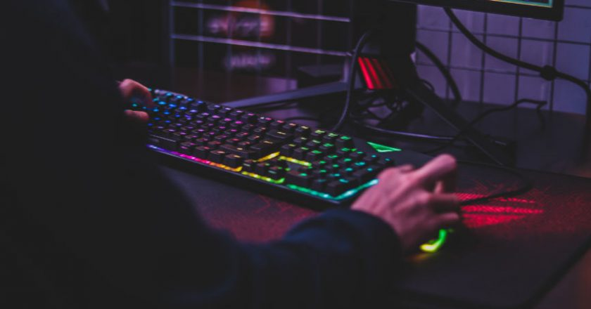 Person sitting in front of a gaming keyboard