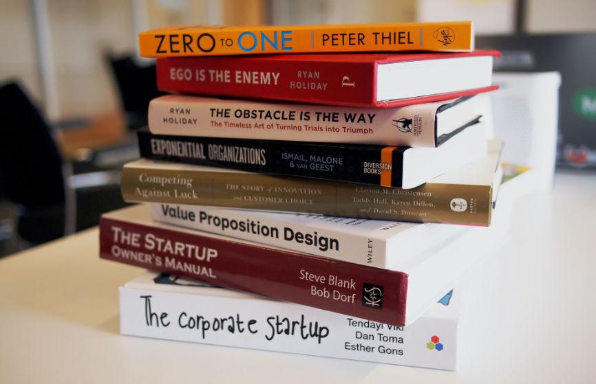 A stack of books on Entrepreneurship