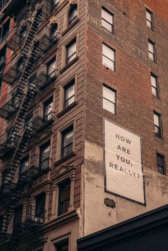 """Sign on side of building that reads """"How are you really?"""""""