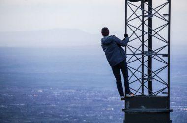 Man climbing 5G cell Tower