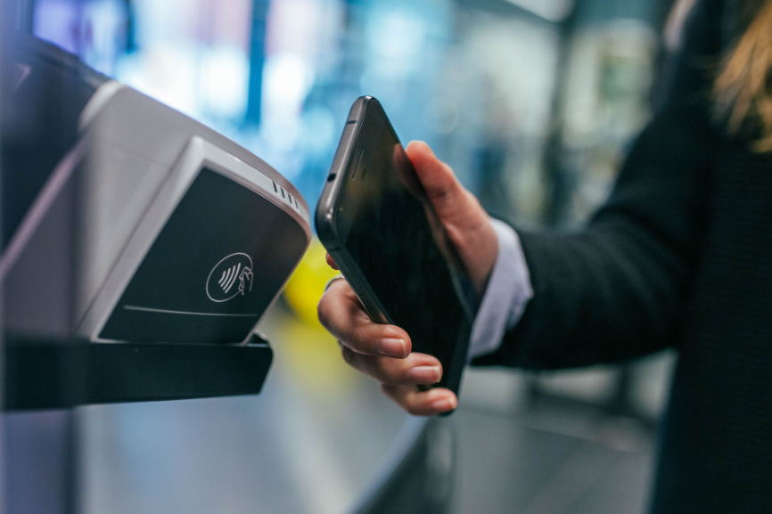 Swiping smartphone for payment processing demonstrating Financial Technology