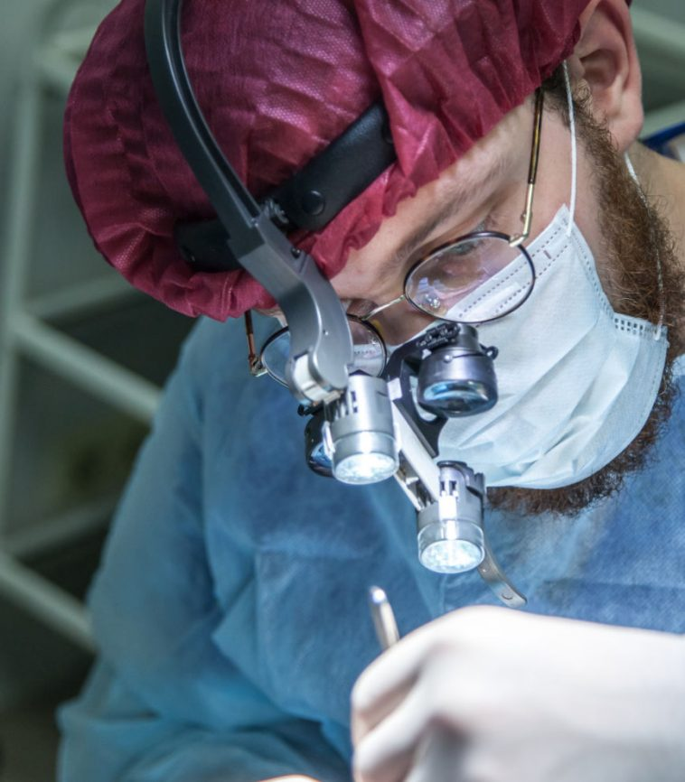Dentist performing Full Mouth Reconstruction