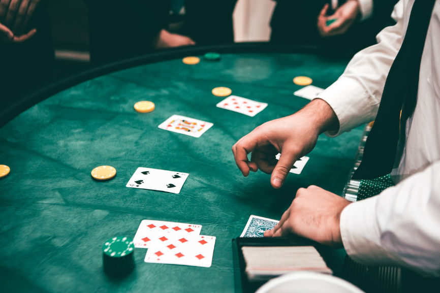 People and Dealer at BlackJack table