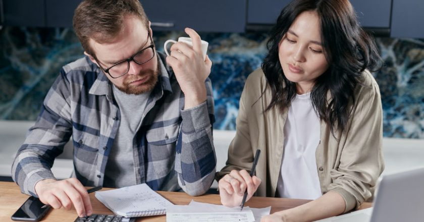 Couple reviewing their bills and debt consolidation